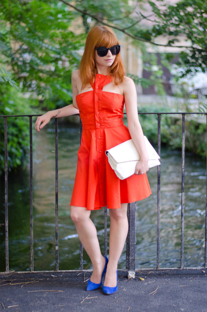 orange outfit with blue shoes